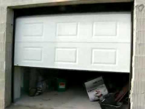 Porte de garage sectionnelle motorisée maguisa